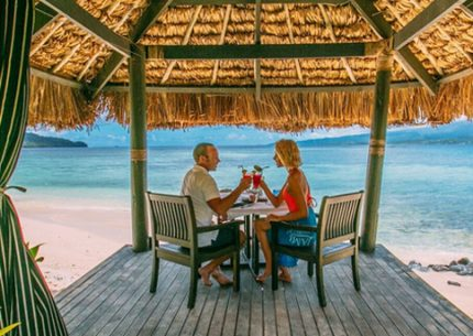 Couple by the beach in Qamea on Romantic Fiji Vacation for two