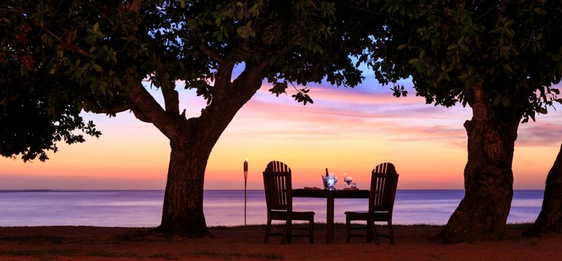 Beachside dining Fiji sunset
