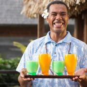 Tropical cocktails served by Fiji resort staff