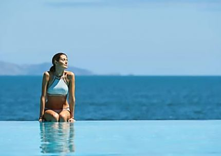 Woman enjoying resort infinity pool on a Fiji weekend getaway