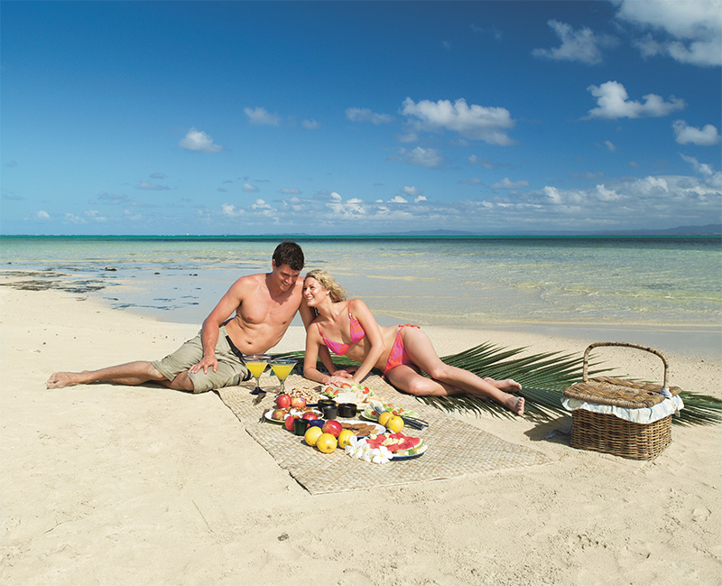 Couple on beach at Jean Michel Cousteau Resort